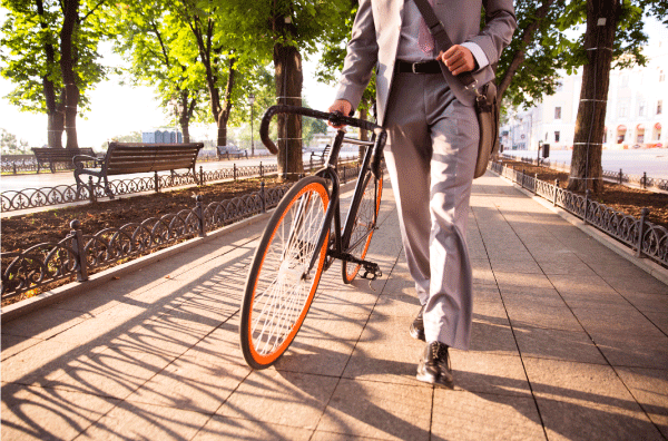 businessman-walking-with-bicycle600_300