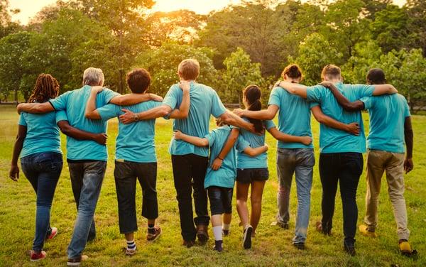 group-of-diversity-people-volunteen-arm-around-UDHZGYT
